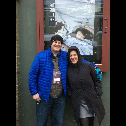 Allison Tolman in a black overcoat poses a picture with boyfriend Tim.