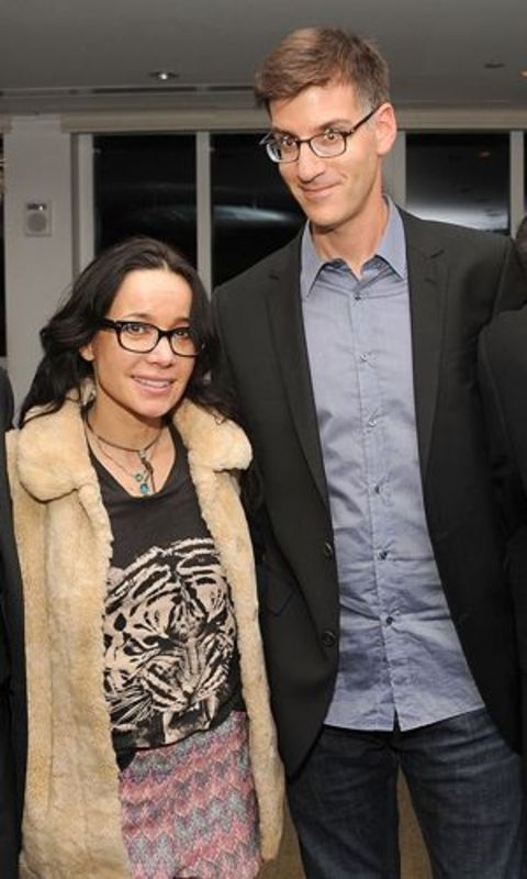 Brody Tate poses a picture with comedian wife Janeane Garofalo.
