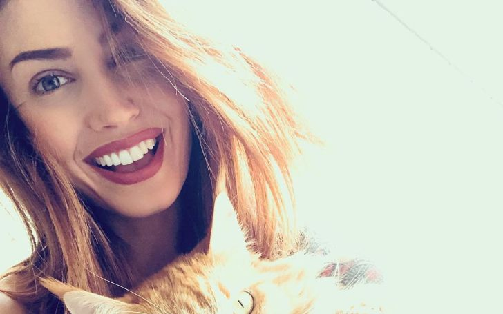Seraina Schonenberger poses with her cat for Instagram.