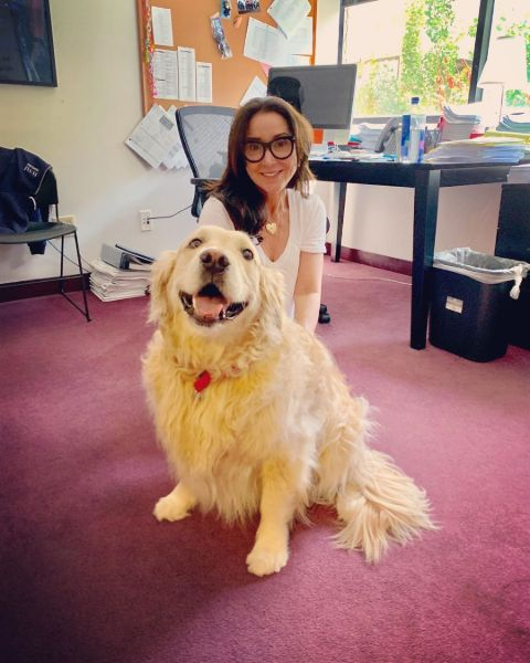 Marney Hochman poses a picture with her dog.
