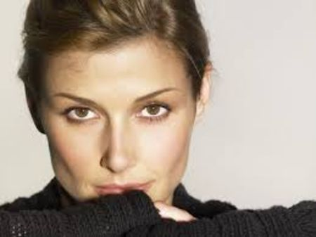 Bridget Moynahan in a black top poses for a photoshoot.