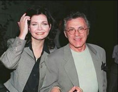 Randy Clohessy in grey coat poses with ex-husband Frankie Valli.