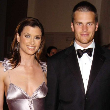 Bridget Moynahan in a pink dress poses with husband Andrew Frankel in a black tux.