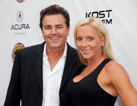 Cara Kokenas in a black dress poses a picture with husband Christopher Knight.