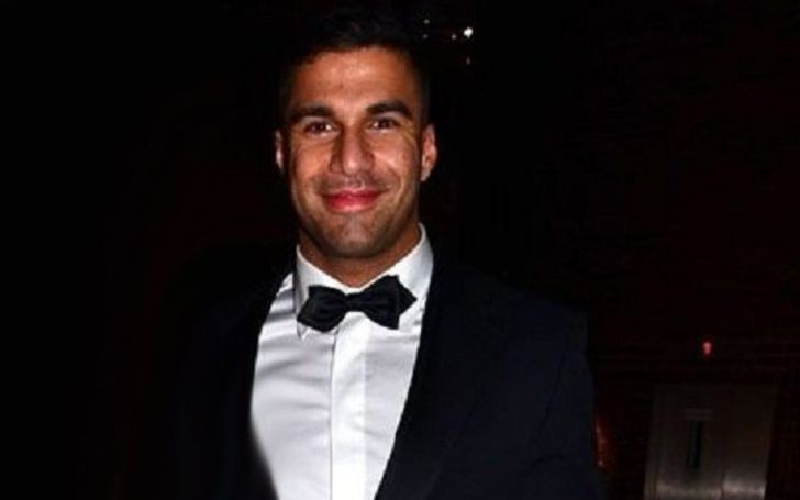 Ramtin Abdo in a black tux poses for a picture.
