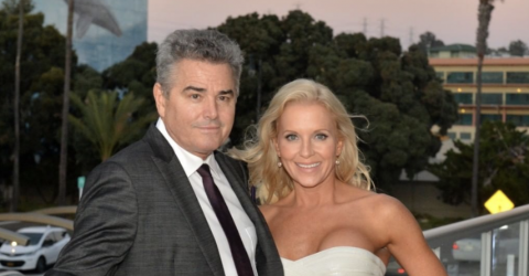 Cara Kokenas in a white dress poses for a picture with Christopher  Knight.
