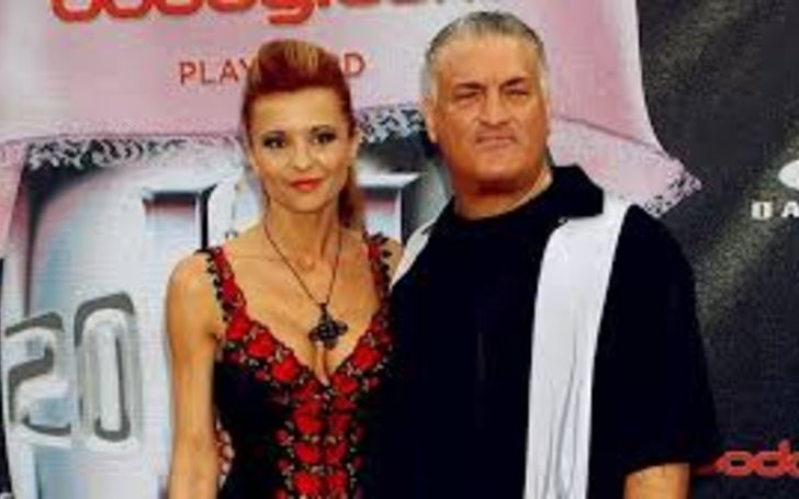 Evanka Franjko in red dress poses with husband Joey Buttafuoco.