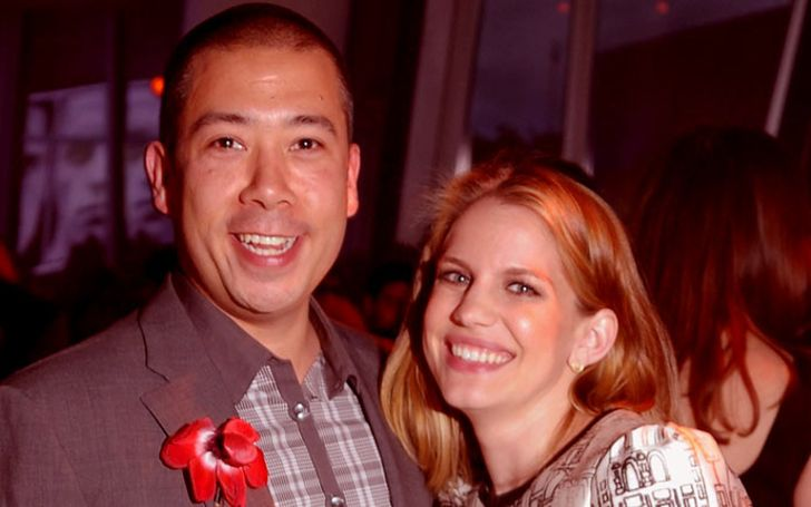 Shaun So in a grey shirt poses with Anna Chlumsky.