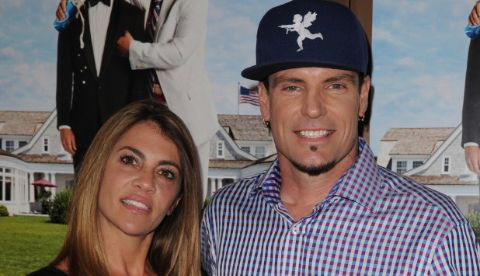 Laura Giaritta and her ex-husband Vanilla Ice on right pose for a picture.