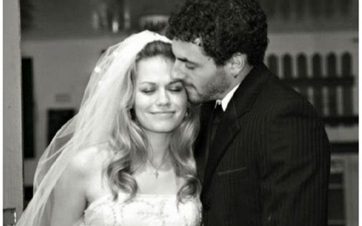 Michael Galeotti in black suit kissing his ex-wife Bethany Lenz.