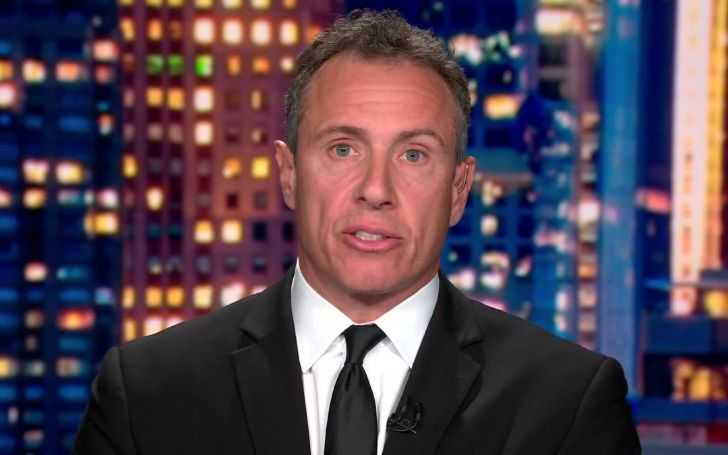 Chris Cuomo in a black coat and tie caught on camera.