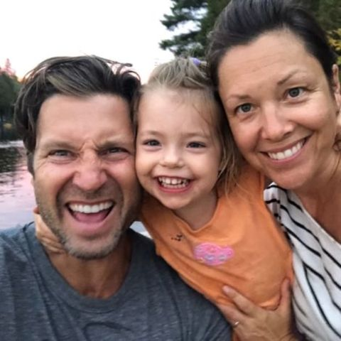 Damon Runyan with his partner Jodie Dowdall and kid Ruby Runyan.