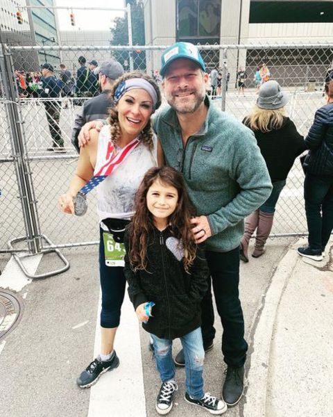 Jason Carr with his spouse Taryn Asher and daughter Gia Carr
