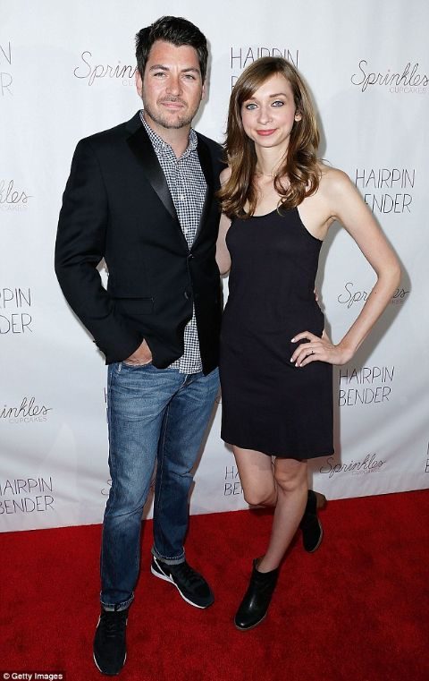 Lauren Lapkus in a black dress posing with ex-lover Chris Alvarado.