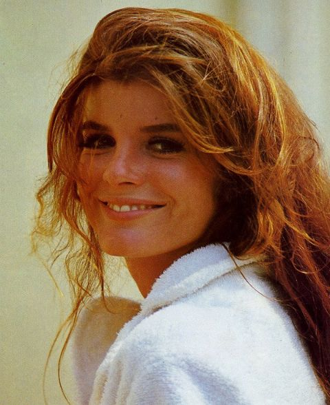 Katharine Ross in a white t-shirt poses for a picture.