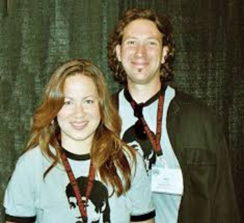 Ian Keasler in black at right poses with wife Shannon Lee.