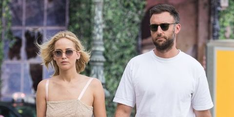 Cooke Maroney in a white t-shirt walking in the streets with wife Jennifer Lawrence.