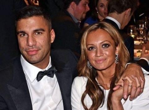 Ramtin Abdo poses with ex-wife Kate Abdo at an event.