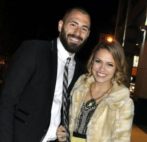 Michael Galeotti in a black suit poses with ex-wife Bethany Lenz.