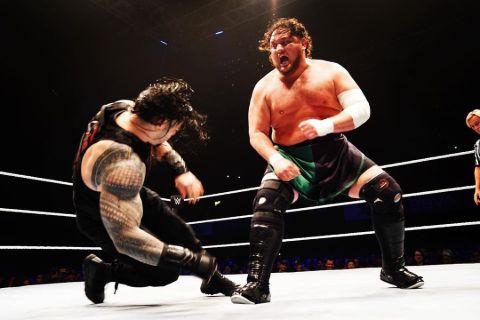 Jessica Seanoa fighting Roman Reigns in a match.
