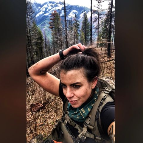 Laura Zerra in a forest poses for a selfie.