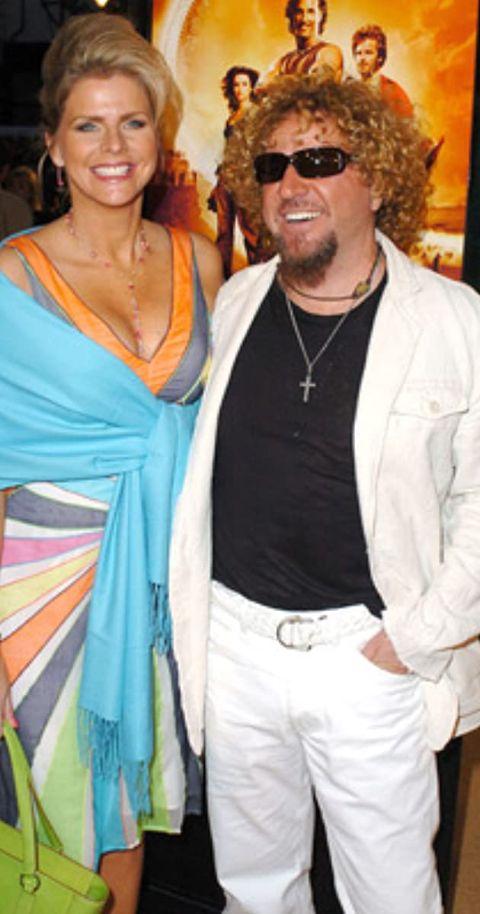 Betsy Berardi in blue dress poses with ex-husband Sammy Hagar.