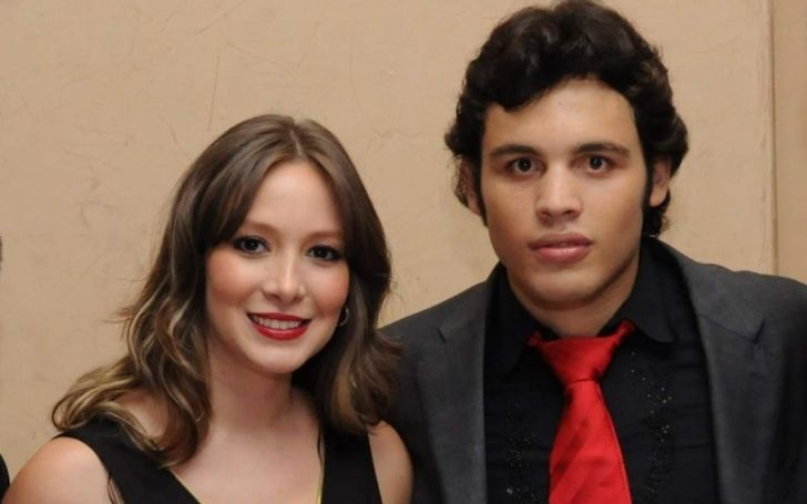 Frida Chavez in a black dress poses with husband Julio Cesar Chavez Jr.