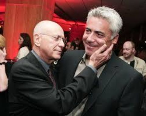 Jeremy Yaffe's son Adam Arkin and Alan Arkin hugging at an event.