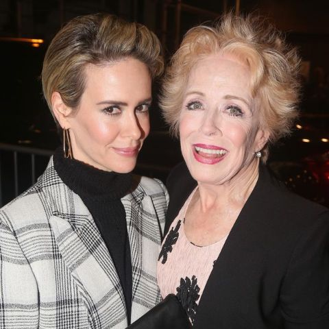 Holland Taylor in black poses with her lover Sarah Paulson.