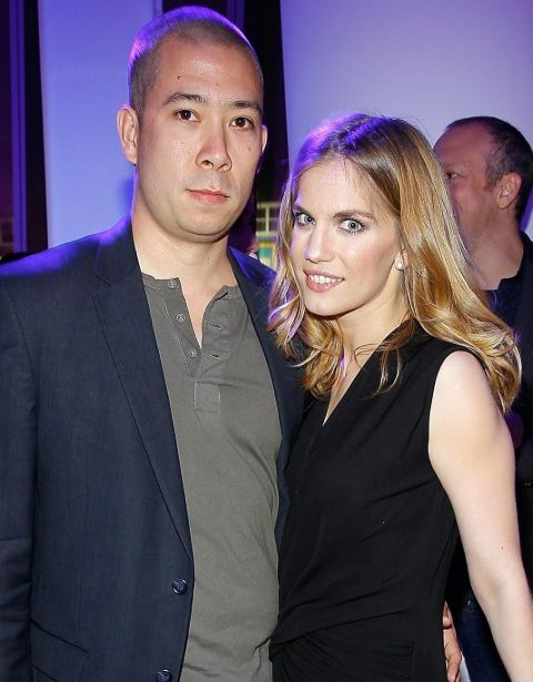 Shaun So and wife Anna Chlumsky pose at an event.
