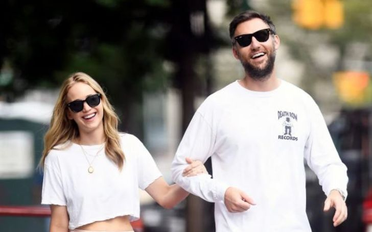 Cooke Maroney in a white t-shirt poses a picture with wife Jennifer Lawrence.