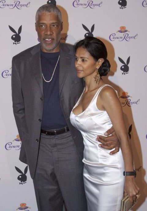 Dorys Madden in white dress poses with husband Julius Erving.