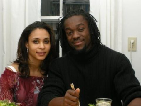 Kori Campfield in left poses with her husband Kofi Kingston.