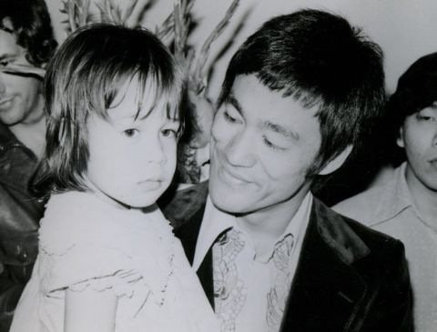 Ian Keasler's wife as a baby with her father Bruce Lee.