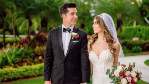 Jesse Watters in a black suit poses with wife Emma DiGiovine.