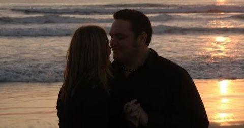 Jessica Seanoa and  Samoa Joe hugging  in a beach.