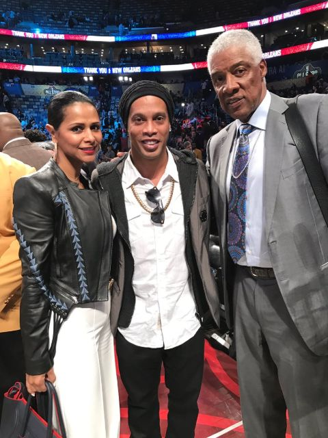 Dorys Madden and her husband Julius Erving poses with Ronaldinho.
