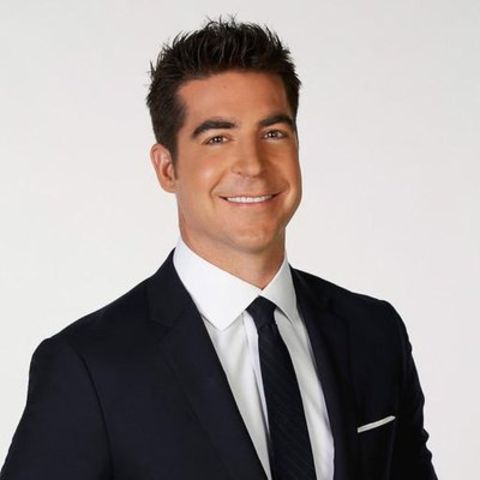 Jesse Watters in a black suit and tie poses for a picture.
