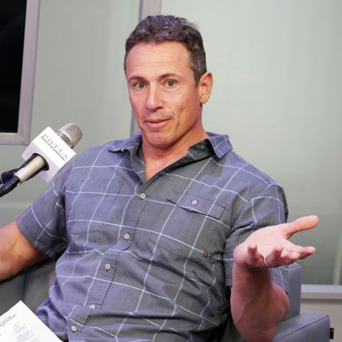 Chris Cuomo in a blue shirt caught on camera during an interview.