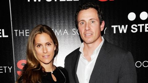 Chris Cuomo in a black coat poses with wife Cristina Greevan.