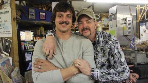 Travis Maldonado in grey t-shirt alongside Joe Exotic.