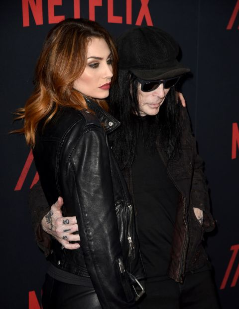 Seraina Schonenberger in a black jacket with husband Mick Mars.