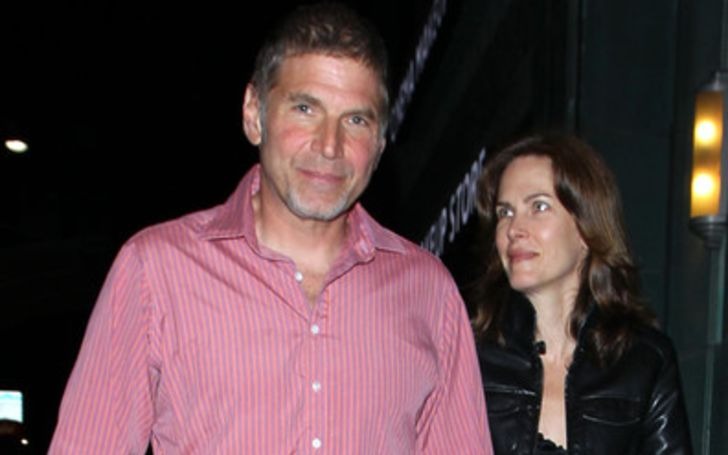 Barbara Chinlund in black poses with husband Nick Chinlund.
