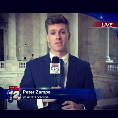 Peter Zampa reporting a news.