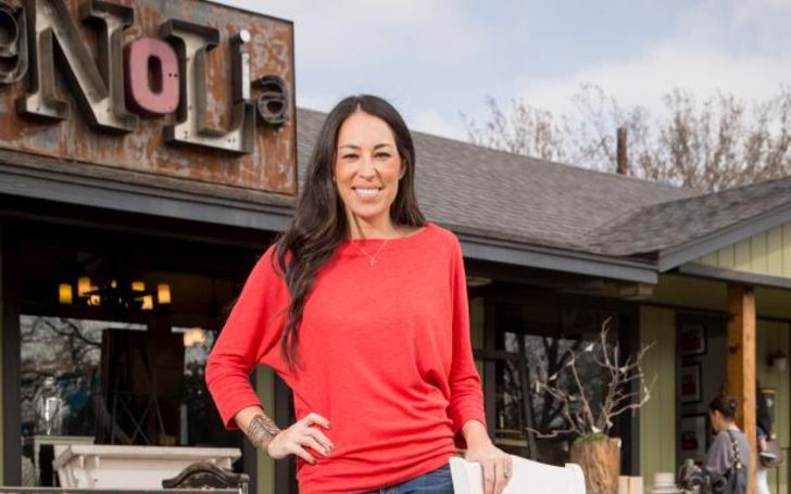 Joanna Gaines in a red t-shirt poses for a picture.