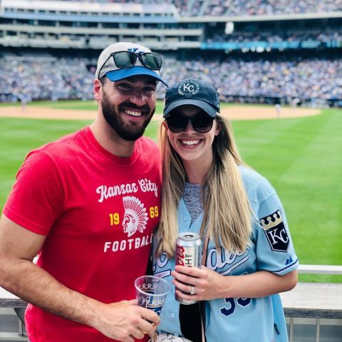 Rachel Ramsey in a blue t-shirt poses with husband.