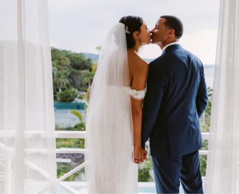 Errol Barnett kissing his wife Ariana Tolbert.