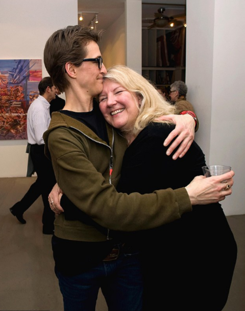 Rachel Maddow poses a picture with her partner Susan Mikula.
