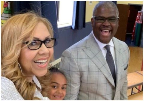 Yvonne Payne poses a picture with husband Charles Payne.