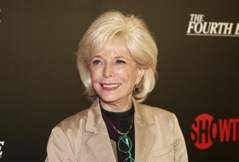 Lesley Stahl in a brown coat poses for a picture